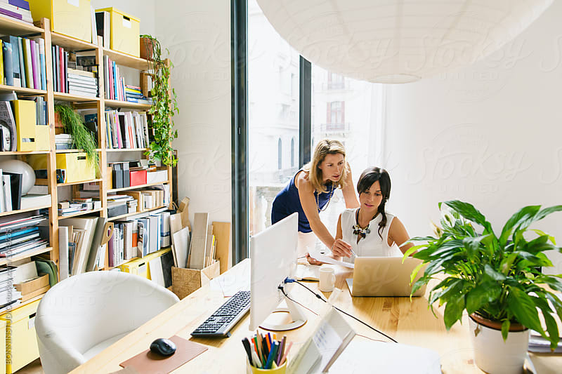 Female team working together in a beautiful bright studio. by BONNINSTUDIO for Stocksy United