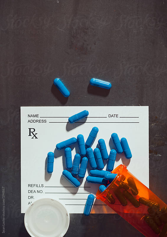 Medicine: Drugs And Bottle On Top Of Doctor's Prescription Paper by Sean Locke for Stocksy United