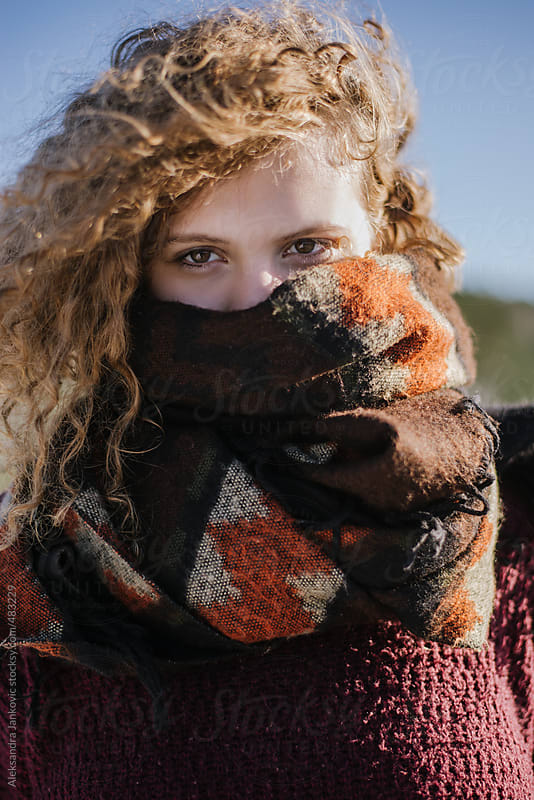 Portrait of a beautiful young woman wearing scarf by Aleksandra Jankovic for Stocksy United