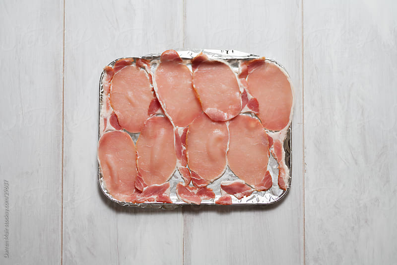Back bacon on a tray by Darren Muir for Stocksy United