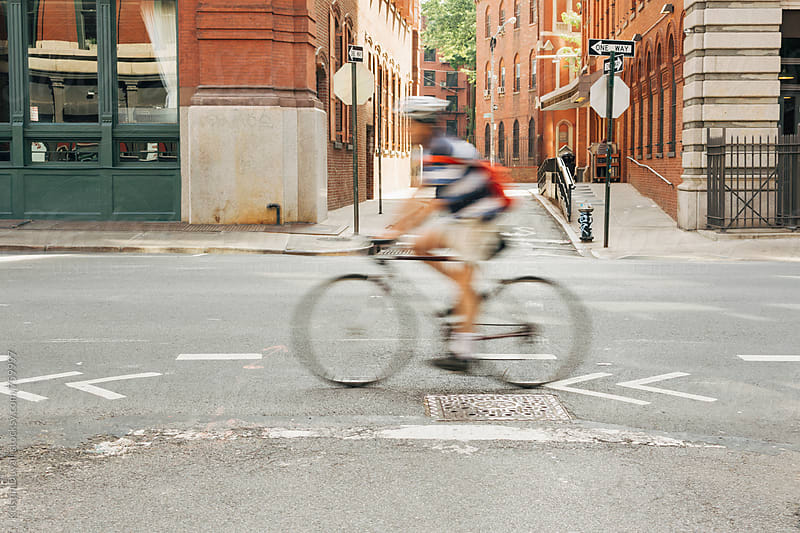Cyclist on city street. New York City. by Kristin Duvall for Stocksy United