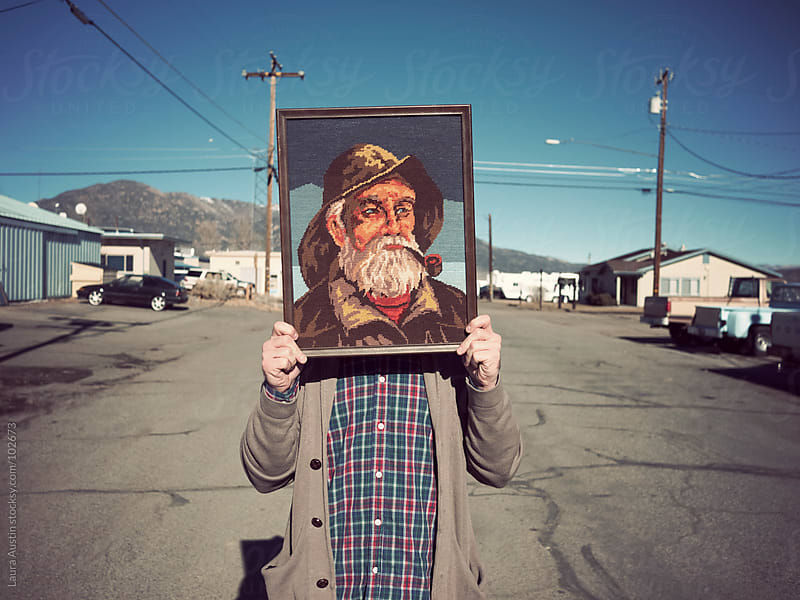 Man Standing In Street With Sailor Art by Laura Austin for Stocksy United