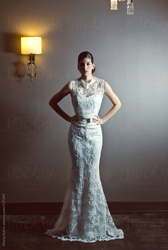 Beautiful brunette bride in white wedding dress ,indoor by Marija Anicic for Stocksy United
