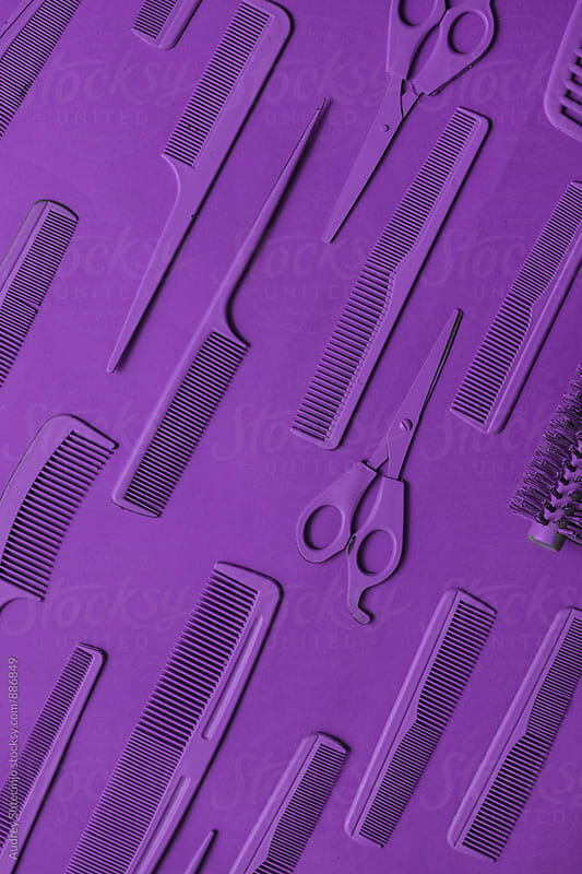 Various hairdresser tools in purple color on purple background. by Audrey Shtecinjo for Stocksy United