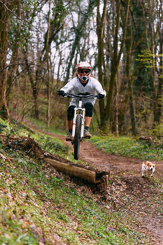 Man ridinig mountain bike by Dimitrije Tanaskovic for Stocksy United