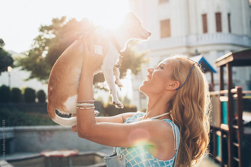 Happy Woman Playing With Her Dog by Lumina for Stocksy United