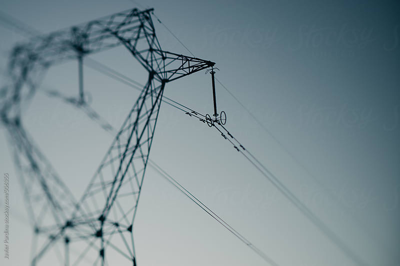 Silhouette of an electric tower.                                                     by Javier Pardina for Stocksy United