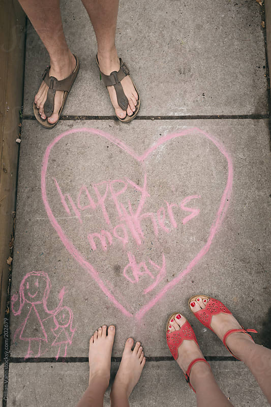 happy mother's day sign in chalk, with the family by Gillian Vann for Stocksy United
