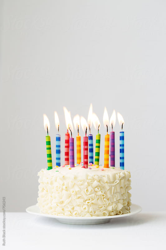 Birthday cake with colorful candles by Ruth Black for Stocksy United