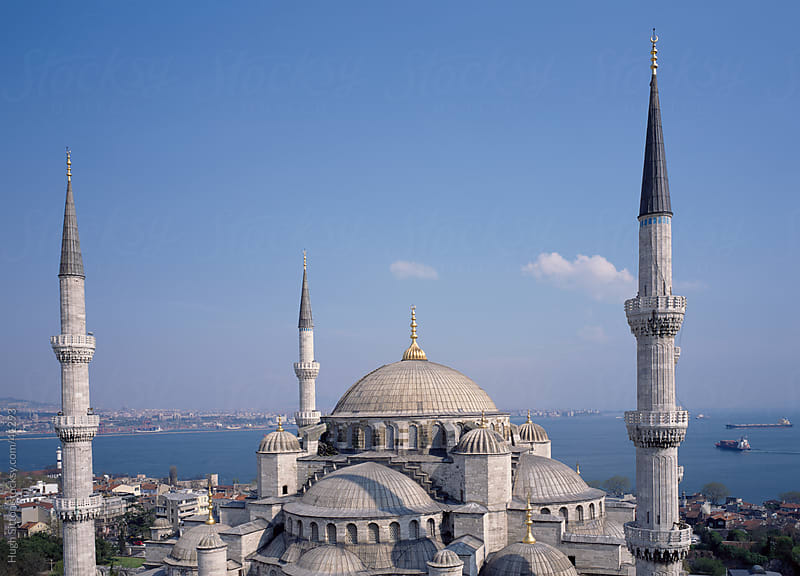 View of the minarets of the Blue Mosque with the Bosphorus behind. Istanbul. by Hugh Sitton for Stocksy United