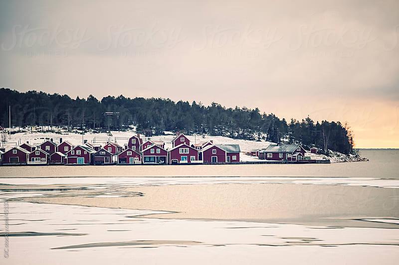 Frozen landscape with a little village in Sweden by GIC for Stocksy United