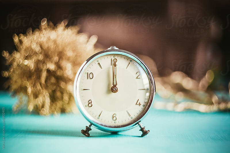 Small old alarm clock and christmas decorations by Vera Lair for Stocksy United