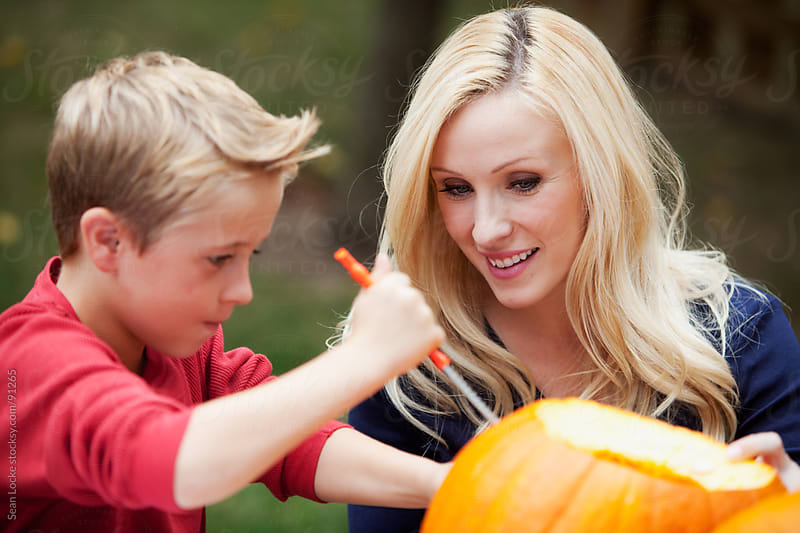 Pumpkins: Son Carves Jack-O-Lantern With Mom by Sean Locke for Stocksy United
