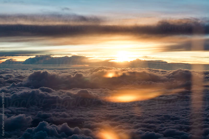 Clouds from a plane by Gary Parker for Stocksy United