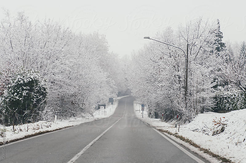 Snowy road by Giada Canu for Stocksy United