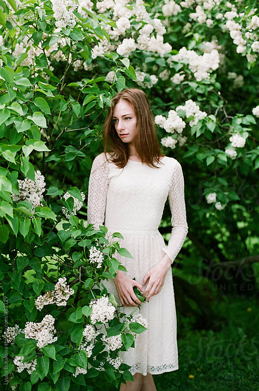 Woman in a white dress by Lyuba Burakova for Stocksy United