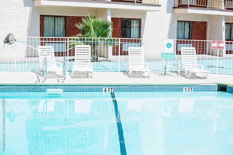 Pool area oustide motel by Image Supply Co for Stocksy United