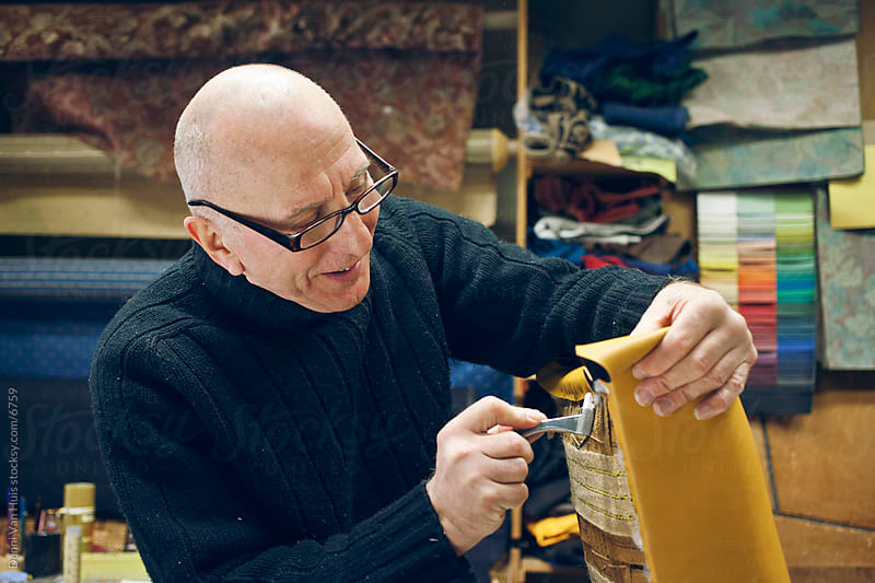 Craftsman working with his hands by Denni Van Huis for Stocksy United