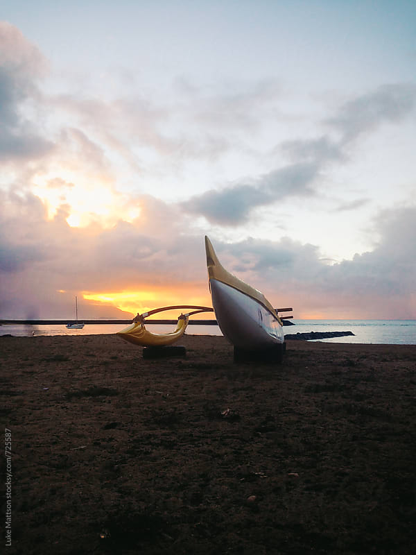 Hawaiian Outrigger Canoe On The Beach At Sunset by Luke Mattson for Stocksy United