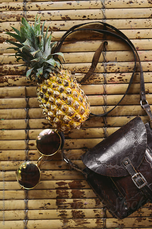 Pineapple With Sunglasses On A Table by Alexander Grabchilev for Stocksy United