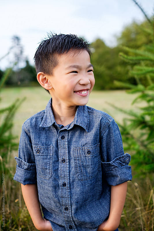 Portrait of an Asian kid outdoor by Suprijono Suharjoto for Stocksy United