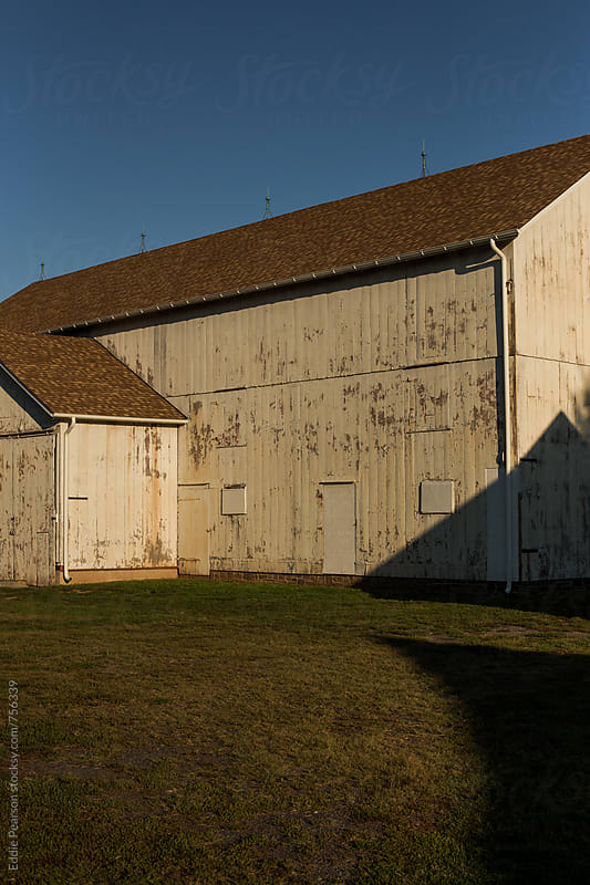 Side of a barn as the sun is setting by Eddie Pearson for Stocksy United