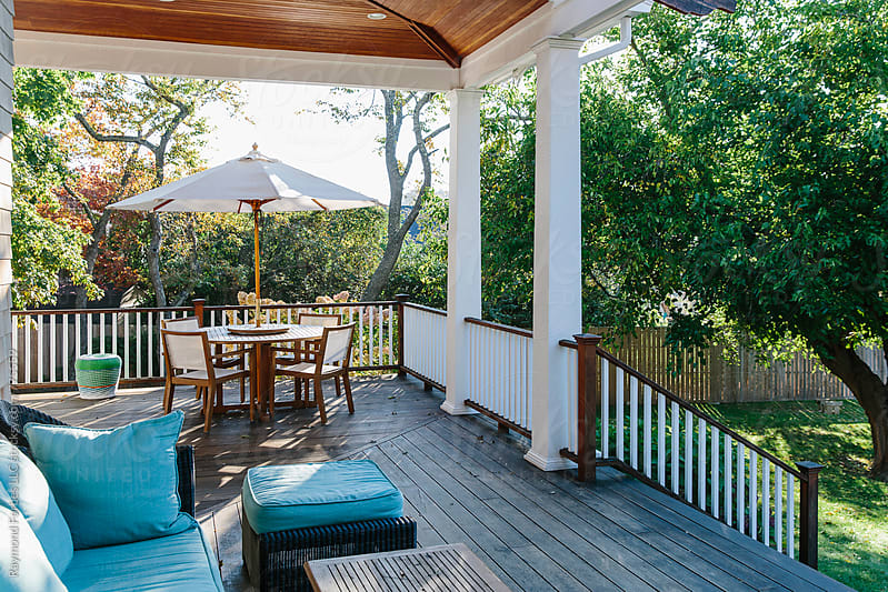 Porch in Autumn Season at home by Raymond Forbes LLC for Stocksy United