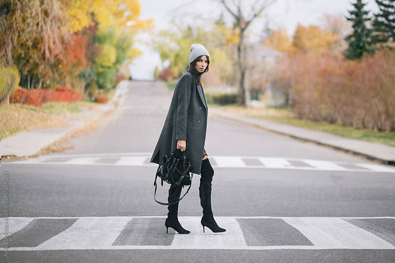 Fashionable girl dress for fall weather outdoors by Ania Boniecka for Stocksy United