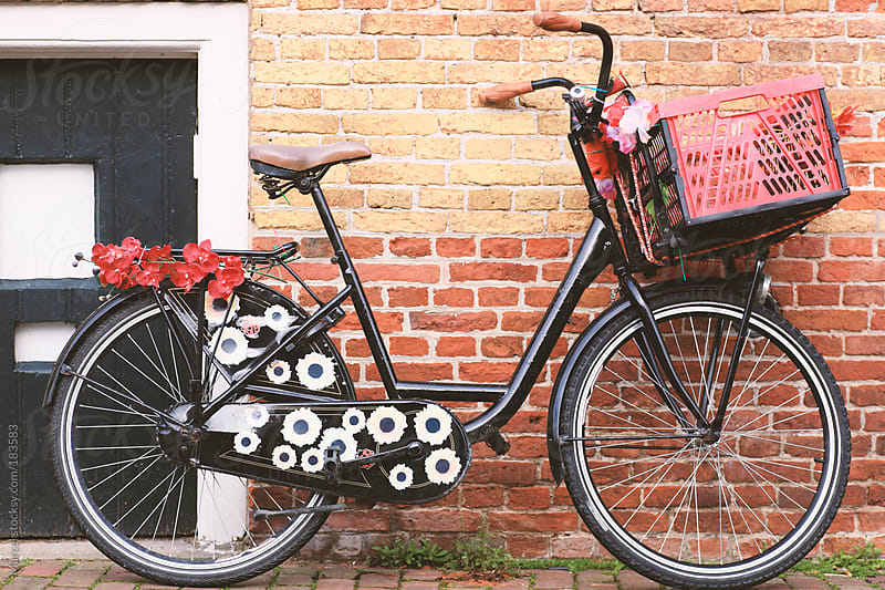 Bicycle decorated with flowers by Marcel for Stocksy United