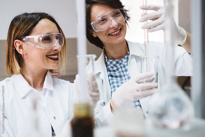 Two Female Chemist Scientists Working in the Lab by Katarina Radovic for Stocksy United