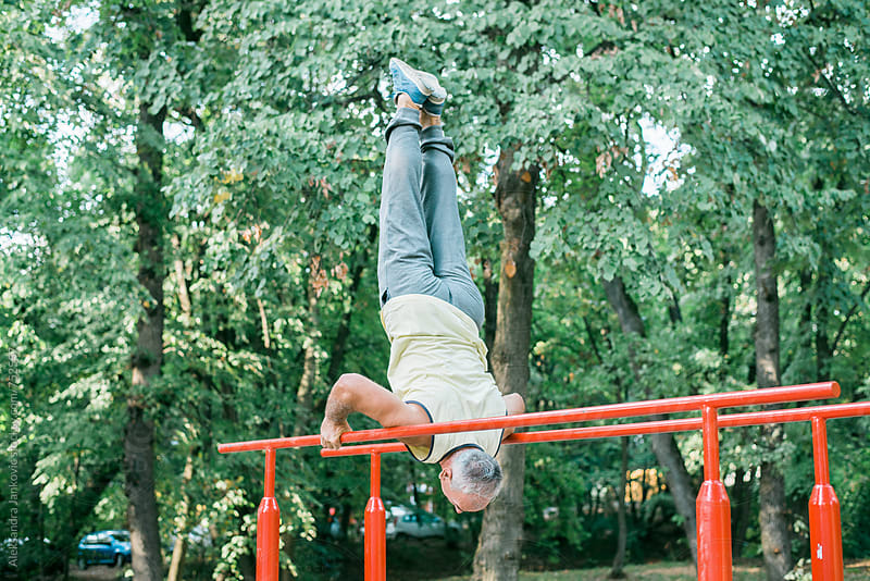 Senior Man Doing Exercise in the Park by Aleksandra Jankovic for Stocksy United