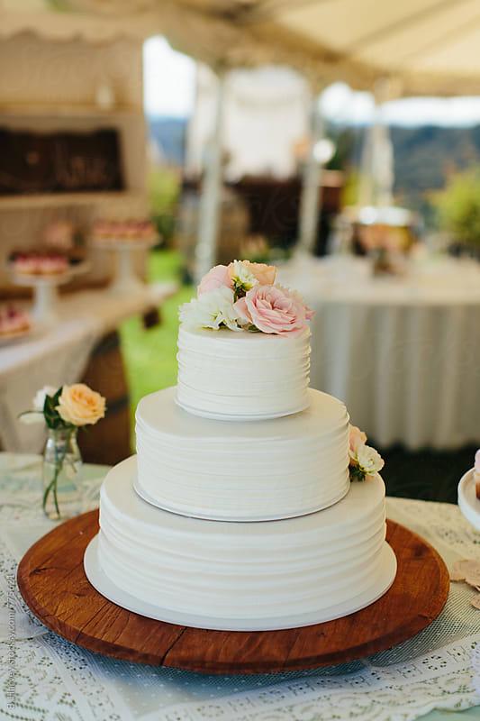 Beautiful, simple, white wedding cake by B. Harvey for Stocksy United