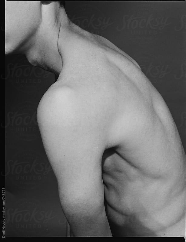 Topless man's torso sideways by T-REX & Flower for Stocksy United