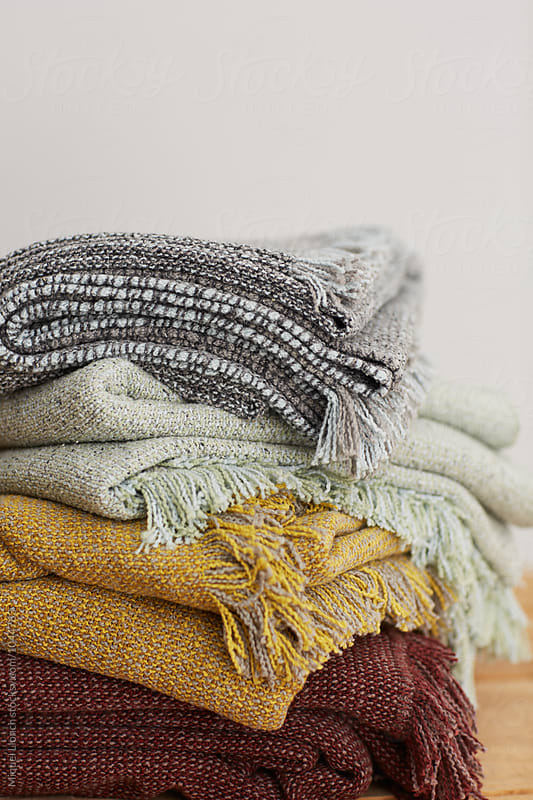 Close up of blankets and plaids by Miquel Llonch for Stocksy United
