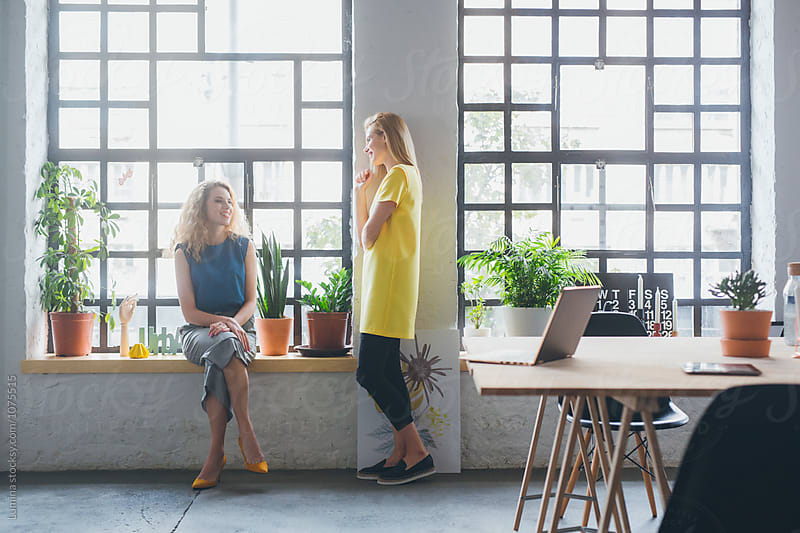 Two Businesswomen Chatting by Lumina for Stocksy United