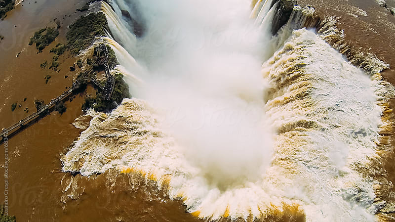 Aerial view of the Devil's Throat in Iguazu Falls by Leandro Crespi for Stocksy United