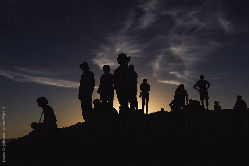 Silhouette of a group of people by Mauro Grigollo for Stocksy United