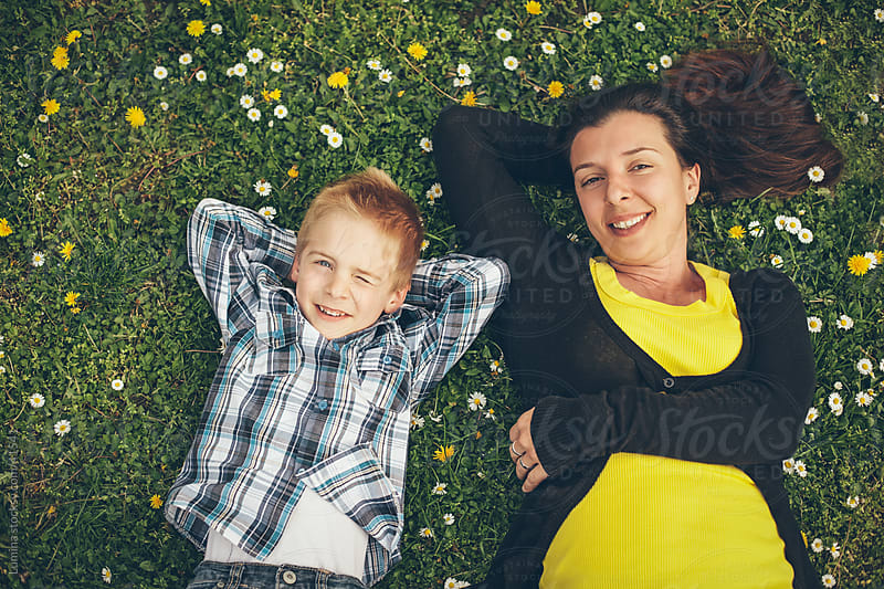 Mother and Son Lying in Grass by Lumina for Stocksy United
