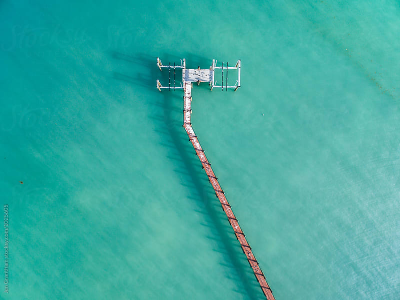 Pier in the ocean by Jen Grantham for Stocksy United