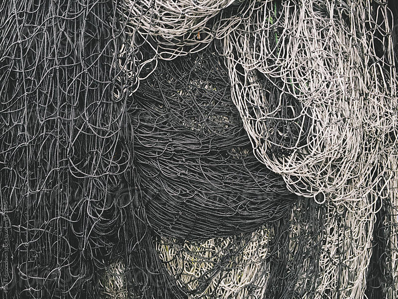 Close up of commercial fishing nets by Paul Edmondson for Stocksy United