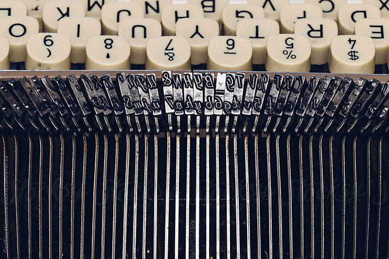 Closeup of Typewriter Keys and Hammers by Geoffrey Hammond for Stocksy United