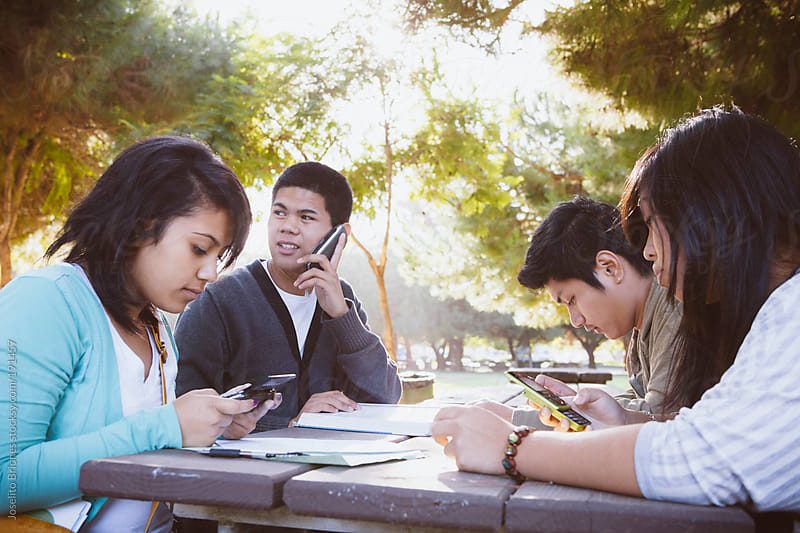New Americans - Minority High School Students Working Together Using Technology after School by Joselito Briones for Stocksy United