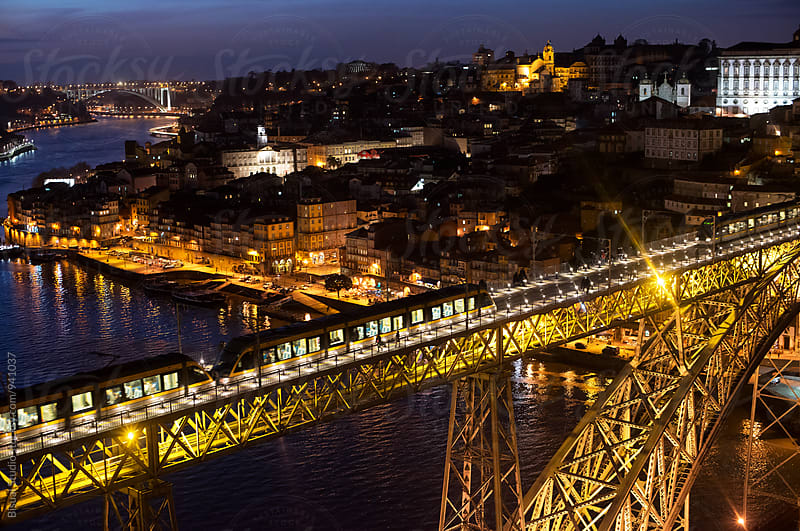 A tram on Dom Luis I Bridge at night, Oporto by Bisual Studio for Stocksy United