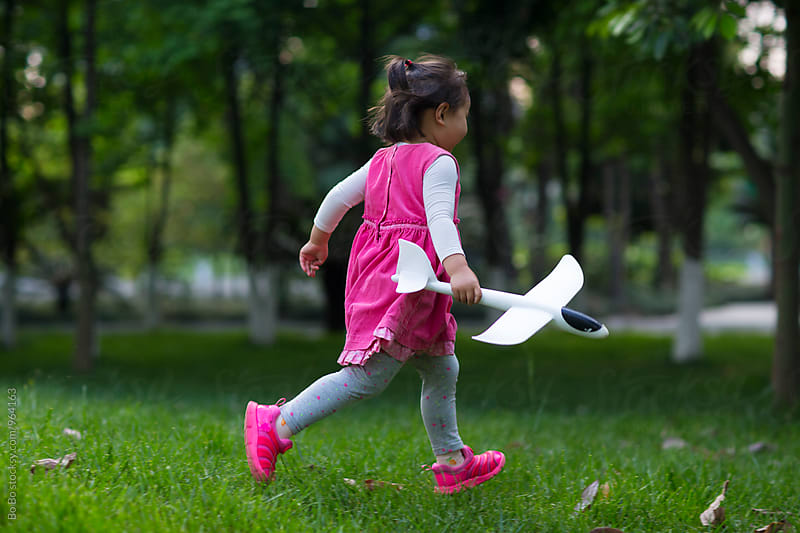 lovely little asian girl running outdoor in the park by Bo Bo for Stocksy United