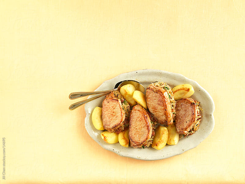 Pork loin and Apples by Jill Chen for Stocksy United