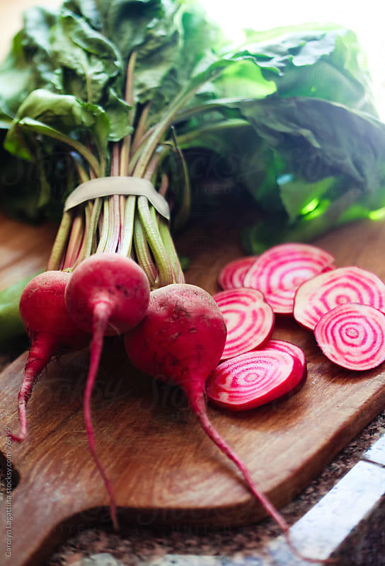 Chioggia beets from the farmers market by Carolyn Lagattuta for Stocksy United