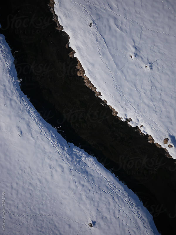 Close-up of winter river from drone by rolfo for Stocksy United