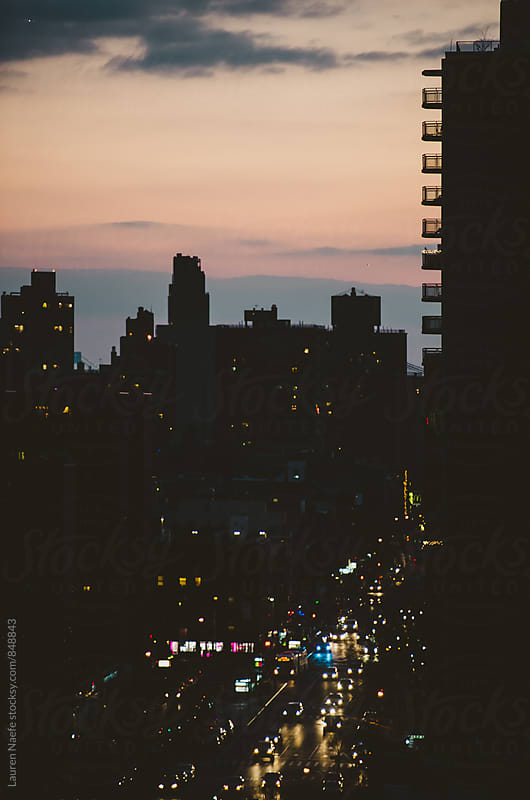 Busy city street at sunset by Lauren Naefe for Stocksy United