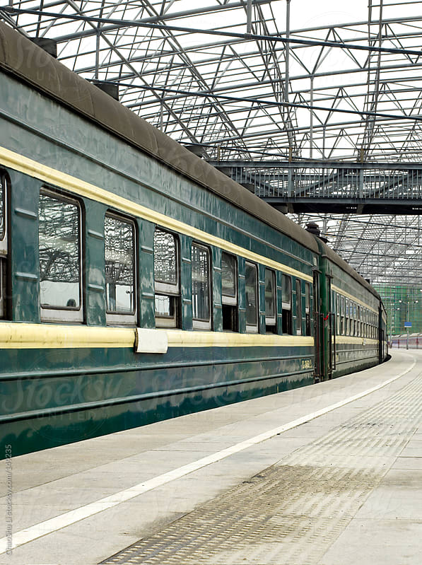 The old train station and Green Train by ChaoShu Li for Stocksy United