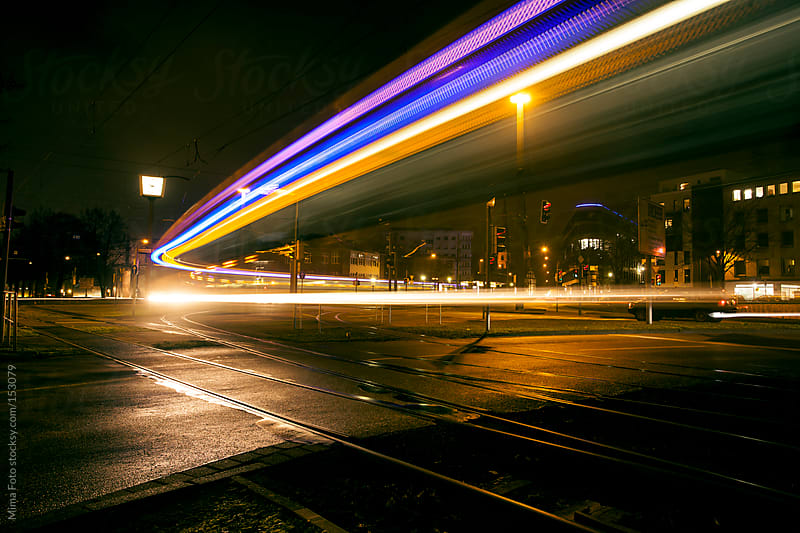 Light trails of passing tram by Mima Foto for Stocksy United